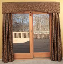 long cream velvet curtain on the golden pole for sliding glass