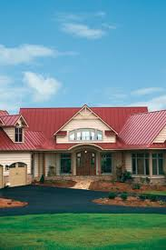 red roof neutral exterior paint with a rustic feel lake house
