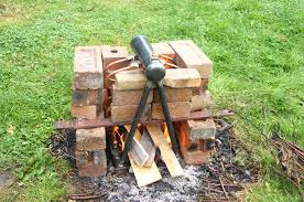 i built a little brick hearth to house the boiler making sure to keep the downcomers outside the fire to ensure convective circulation of the water