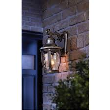Outdoor Wall Sconce With Motion Sensor Mccarthy 1 Light Bronze With Gold Highlights Outdoor Motion Sensor