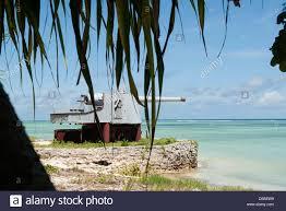 an abandoned world war ii coastal defense gun on red beach three