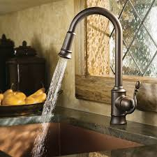moen 7615orb woodmere one handle high arc pulldown kitchen faucet