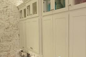 glass door kitchen cabinet lighting new york kitchen remodel features white kitchen cabinets