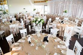 wedding arches newcastle beige tiffanychairs candelabra freshflowers backdrop