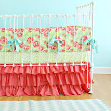 bedroom nursery design using coral and turquoise bedding plus rug