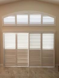 Plantation Shutters On Sliding Patio Doors by Interior View Of Plantation Shutters On A Glass Front Door The