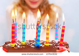 popular free young blowing out candles at birthday party