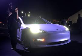 tesla u0027s musk hands over first model 3 electric cars to early buyers