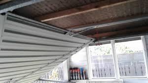 garage door opener consumer reports tilt garage door with newly installed merlin garage door opener