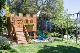 building our backyard castle with wood naturally emily henderson