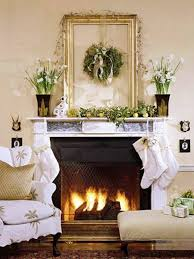 interior mantel decor with vases and flowers wreath blank frame