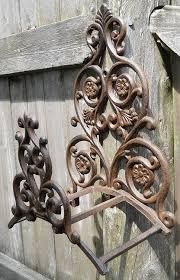 amazon com fancy iron garden hose holder wall hose hanger reel