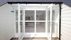full height plantation shutters installed on french doors into a