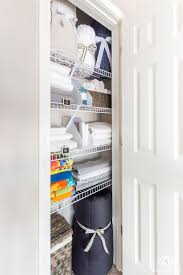 a small organized linen closet and ideas to store bulky bedding