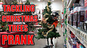 christmas stores tackling christmas trees in stores prank bts