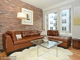 contemporary living room with interior brick u0026 crown molding in