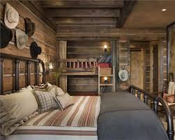 elegant rustic bedroom with wood plank cladding and wall decor