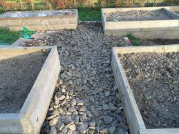Vegetable Beds A Stone Pathway Between Raised Vegetable Beds Mom In The Garden