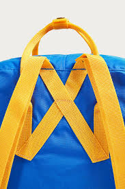 warm yellow fjallraven kanken un blue and warm yellow backpack urban outfitters