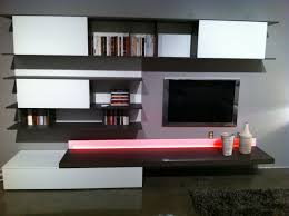 black tv on the gray wall panel combined with white black wooden