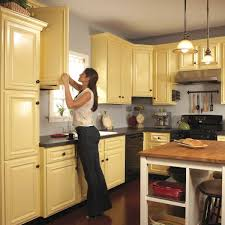 best paint finish for kitchen cabinets how to spray paint kitchen cabinets diy family handyman