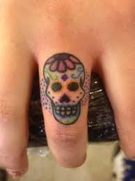 wonderful sugar skull tattoo design make on finger tattooshunter com