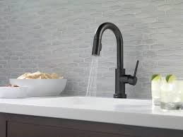 kitchen faucet white modern kitchen with white countertops and black faucet using an