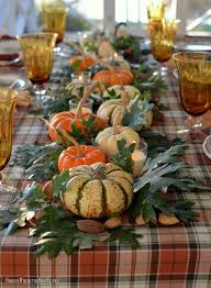 thanksgiving table with turkey thanksgiving table with assorted turkey plates plaid tablecloth and