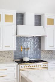what tile goes with white cabinets bright kitchen features a neutral and blue patterned tile