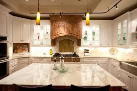 white kitchen cabinets with glass doors mesmerizing white marble countertops gas range white subway tile