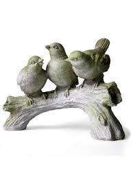 three singing birds on a log garden statue gardeners