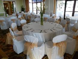 chair covers for rent alternating burgundy and gold organza bows on white chair covers