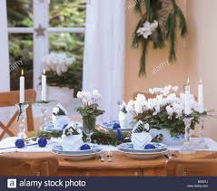 Christmas Bauble Table Decoration by Cyclamen And Blue Baubles As Christmas Table Decoration Stock