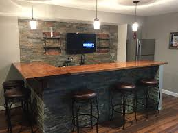 man cave basement bar ledge stone and butcher block bar
