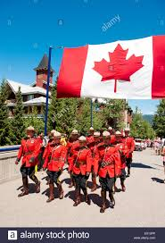 Red Flag Day Royal Canadian Mounted Police Officers Parade Under A Canadian