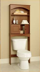 oak bathroom space saver over toilet