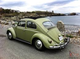 volkswagen beetle green vw beetle with sunroof mint