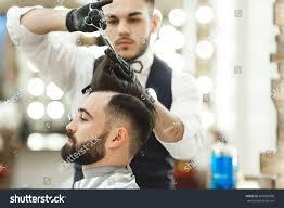attractive barber dark hair wearing white stock photo 390088000