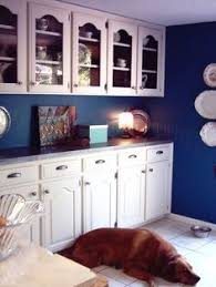 Blue And White Kitchen Cream Kitchen Cabinets With Blue Glass Tile Backsplash Ivory
