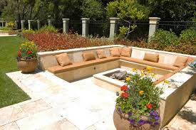 travertine patio with raised planters and pots creates drama and