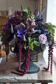 Purple Flowers Centerpieces by Amaranthus Arrangements Pink Flowers Wedding Centerpieces
