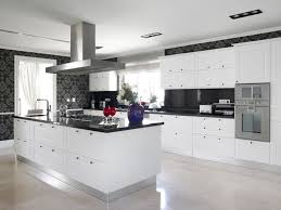 kitchen white washed kitchen island with dark granite countertop black classic wallpaper wall recessed downlights white raised panel kitchen cabinet with built in microwave and