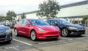image 2017 tesla model 3 in tesla assembly plant parking lot