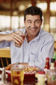 man holding martini kyle chandler laughs last men u0027s journal