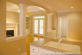 half wall idea to open up the living room space love the arch