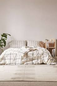 urban outfitters is secretly one of the best cheap home decor wonky grid duvet cover 88 98