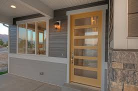 Candlelight Homes Contemporary Front Door With Exterior Stone Floors By Candlelight