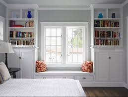 make some diy built in bookcases around the window and on the