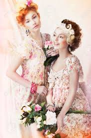 freshness two young pretty women in classic vintage dresses