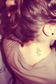 a small black bird tattoo on back of neck photo 3 real photo